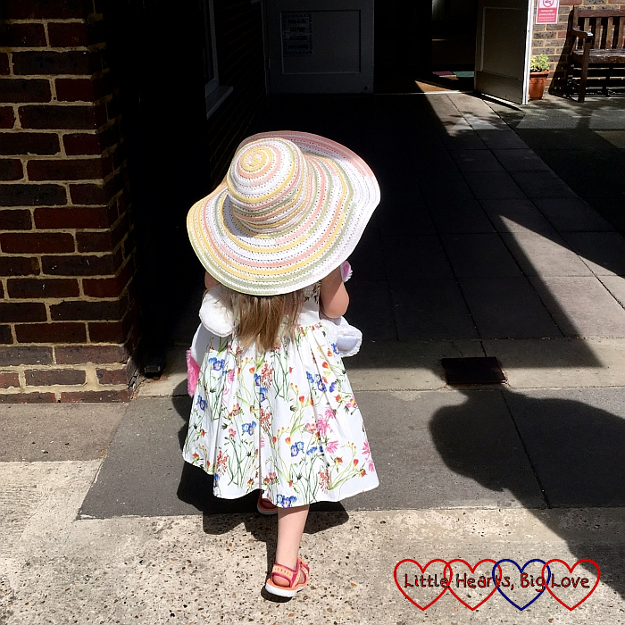 Sophie walking into church wearing her new summer dress and my big sunhat