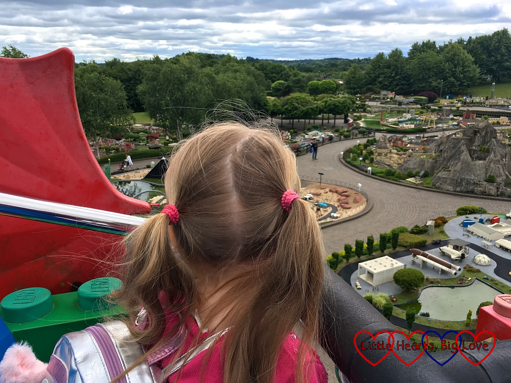 Sophie looking over the new Miniland areas from the Sky Rider ride