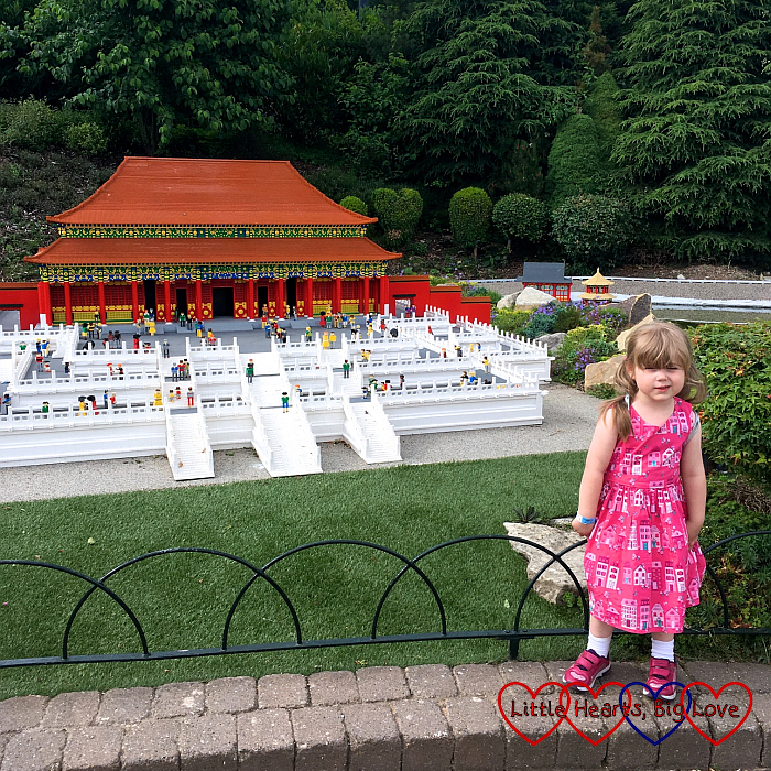 Sophie next to the Forbidden City model in Miniland Around the World
