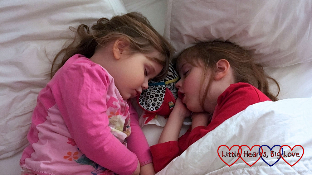 Sophie and Jessica asleep in a big bed together