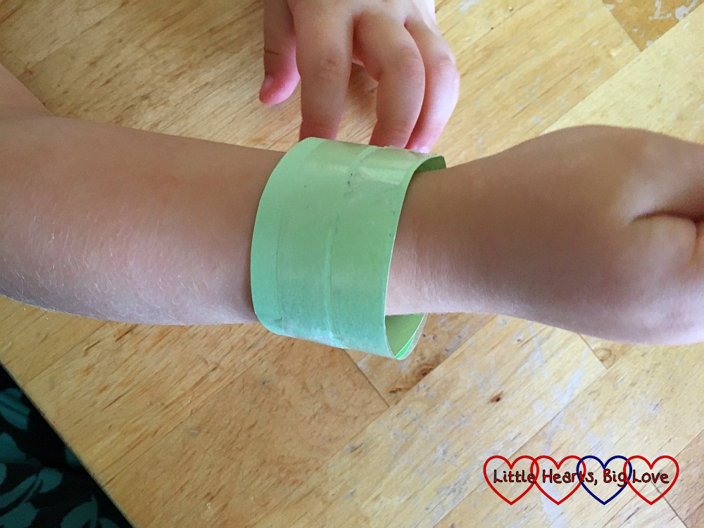 The strip of paper wrapped around Sophie's wrist, covered in double-sided tape