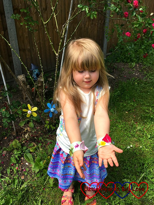Sophie showing off her finished nature bracelets