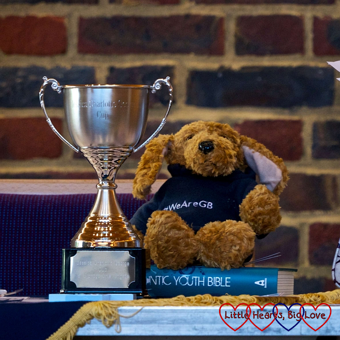The Jessica Charlotte George cup with a Girls' Brigade teddy bear