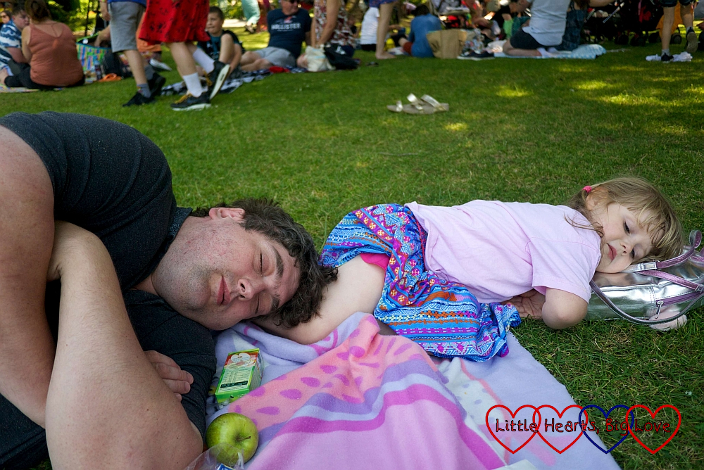 Sophie and Daddy having a nap in the sunshine