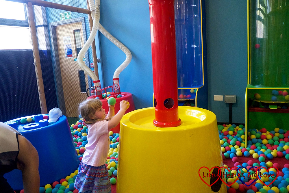 Sophie having fun in George's Spaceship Play Zone soft play area