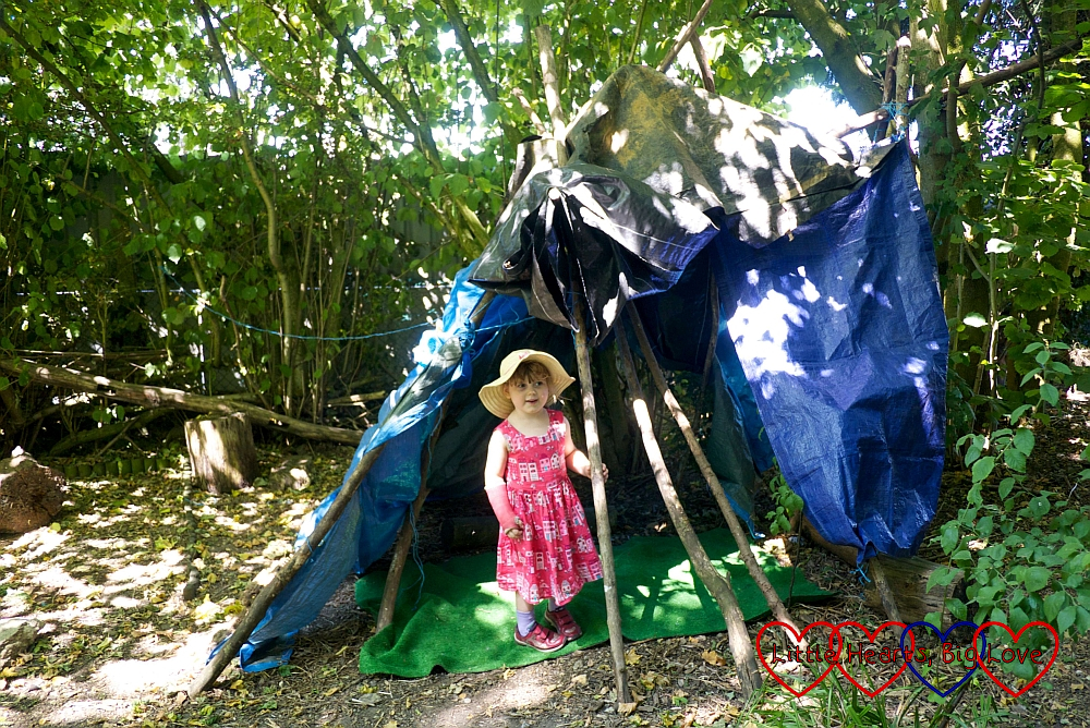 Sophie standing inside one of the dens