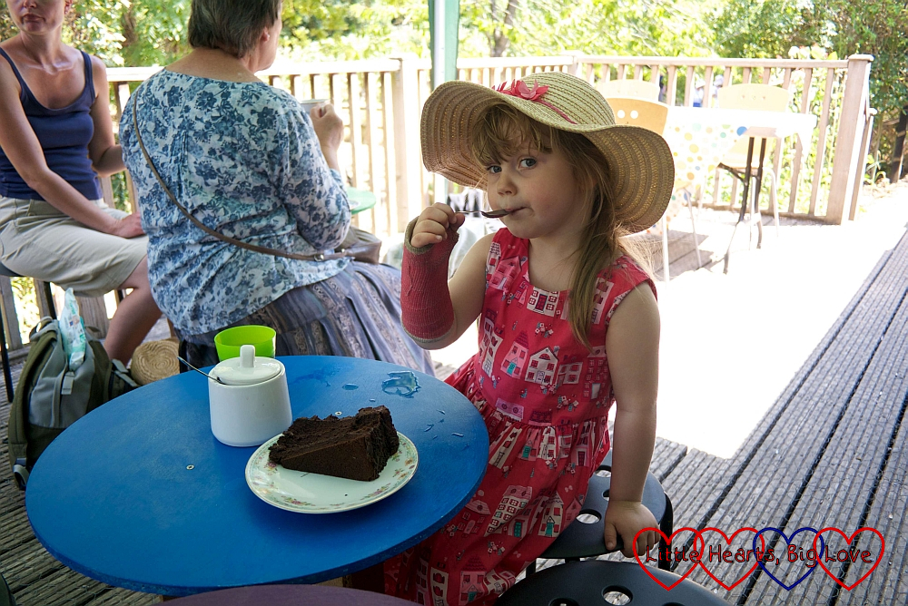 Sophie enjoying a slice of chocolate cake