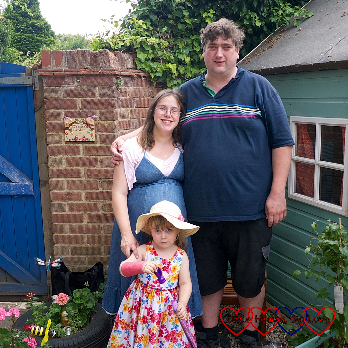 Me, hubby and Sophie standing in Jessica's garden at Sophie's preschool