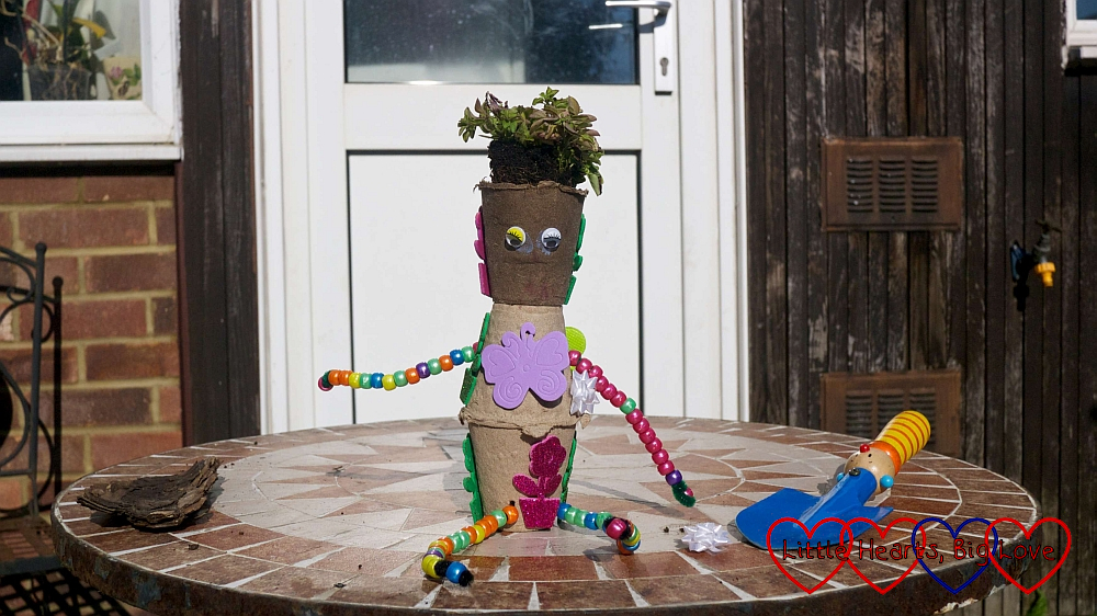 The finished plant pot person complete with oregano hair