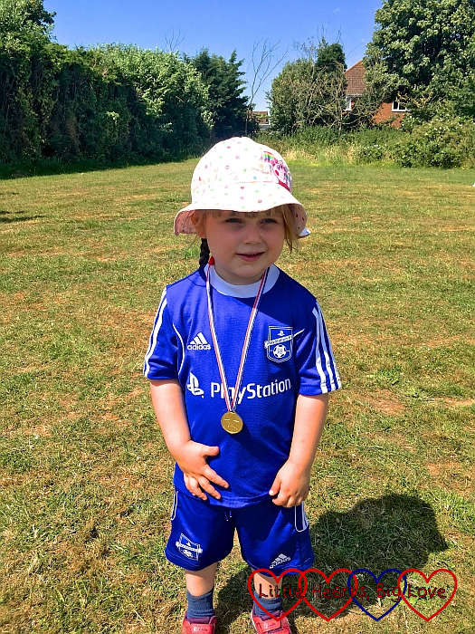 Sophie with her medal at the end of her sports day