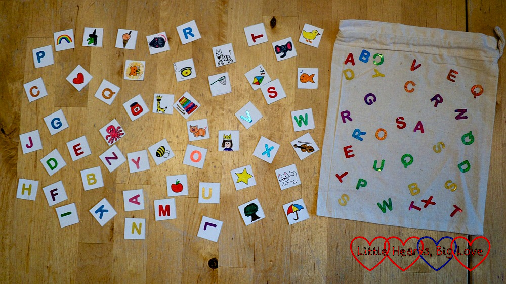 Letter squares and picture squares with a fabric bag covered in letter stickers