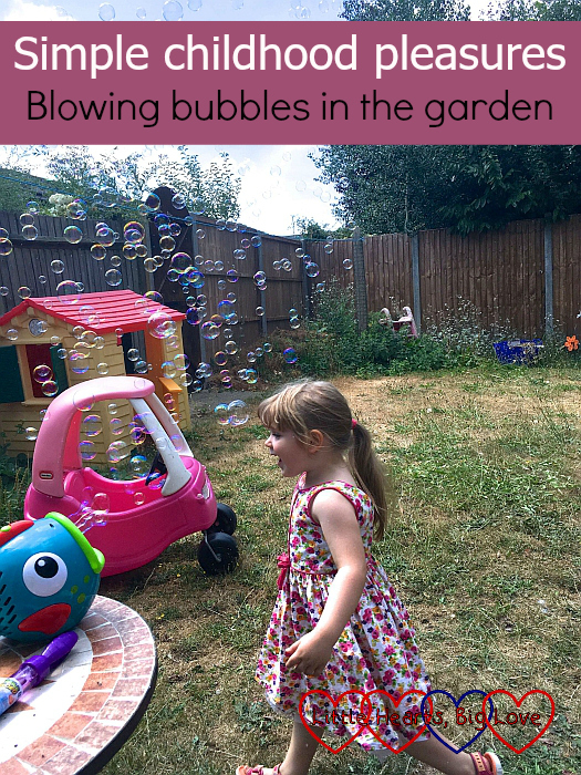 "Sophie running through the bubbles created by her bubble fish - ""Simple childhood pleasures - blowing bubbles in the garden"""