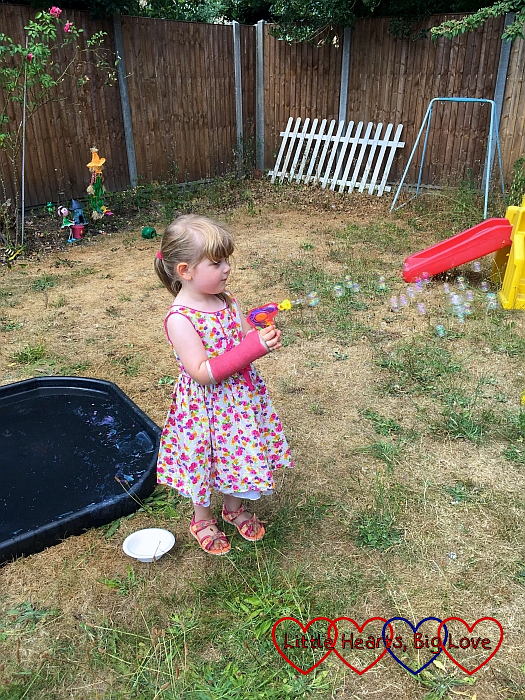 Sophie making bubbles with her bubble gun