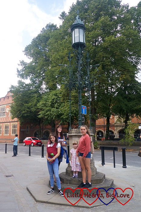 My nieces, sister, Sophie and Thomas standing in front of an ornate lamp post