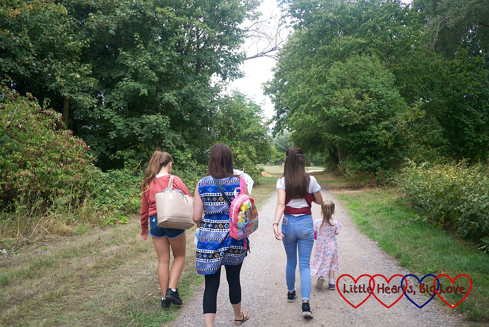 My sister, nieces and Sophie walking through the college grounds