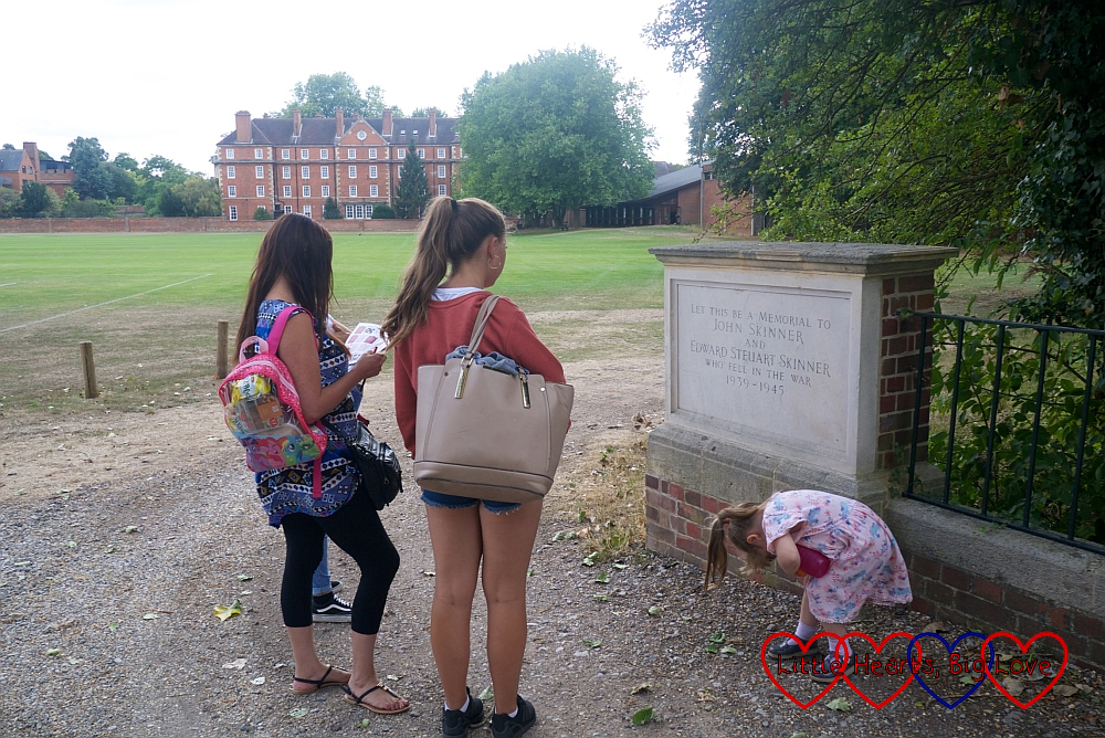 My sister, nieces and Sophie looking at a memorial on a bridge