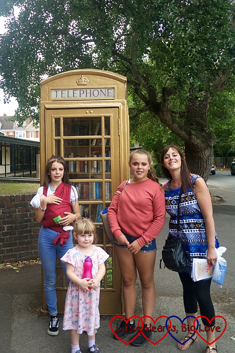 My sister, nieces, Sophie and Thomas in front of a gold telephone box