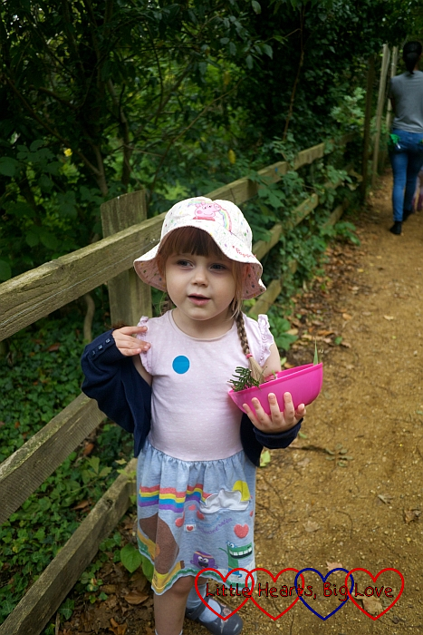 Sophie collecting natural items for her fairy garden