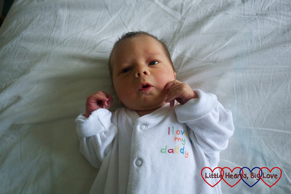 "Baby Thomas wearing a ""I love my daddy"" babygro"