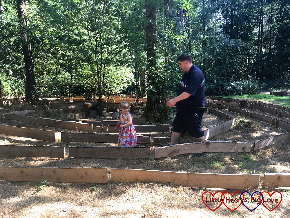 Sophie and Daddy following the labyrinth
