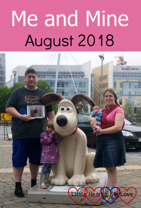 "Me, hubby, Sophie and Thomas with a picture of Jessica at one of the Gromit sculptures - ""Me and Mine - August 2018"""