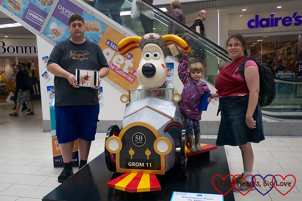 "Me, hubby, Sophie and Thomas with a picture of Jessica at ""Caractacus Paws"""