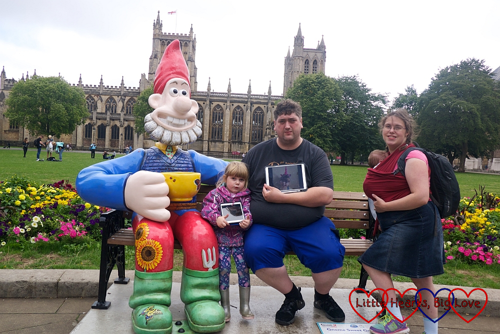 "Me, hubby, Sophie and Thomas with a picture of Jessica at ""Gnome Sweet Gnome"""