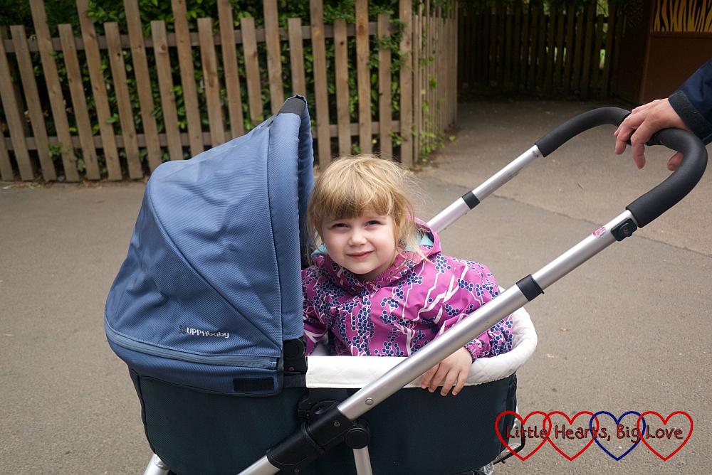 Sophie riding in Thomas's pram