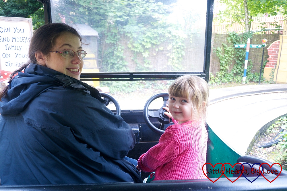 Sophie and Mummy (with Thomas in the sling) on Toadie's Crazy Cars