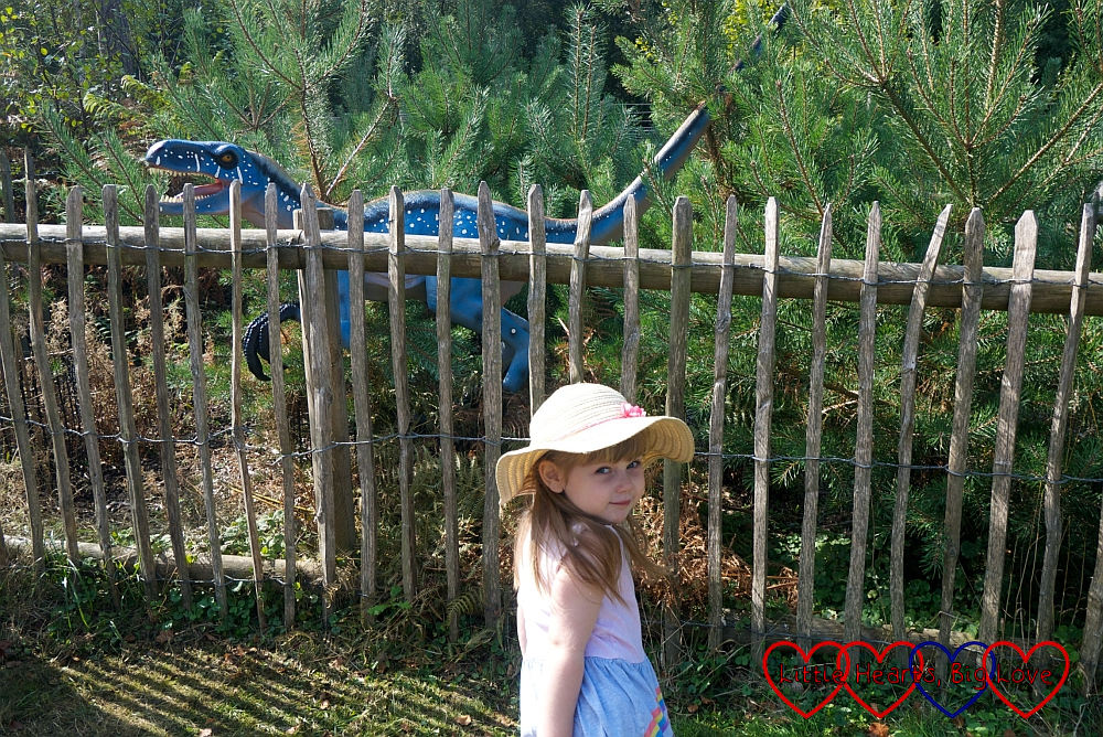 Sophie standing next to one of the dinosaurs in Black Park