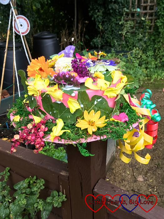 Sophie's finished hat covered with lots of colourful flowers