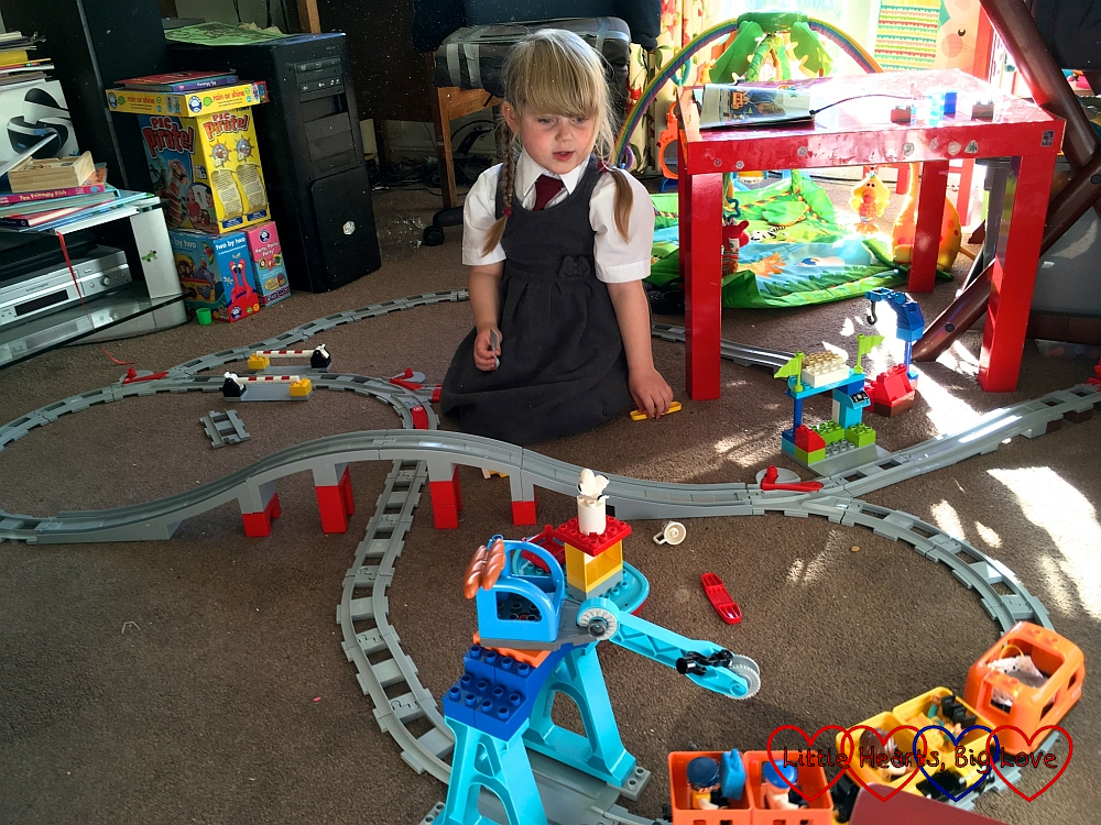 Sophie with her Duplo train set