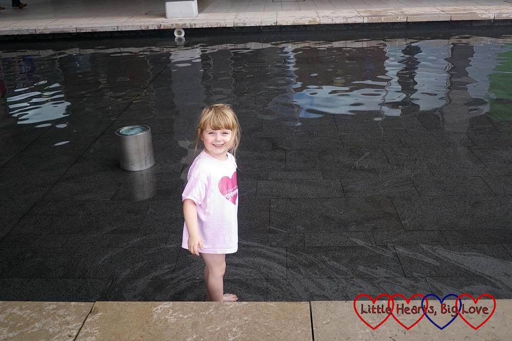Sophie having fun playing in the water