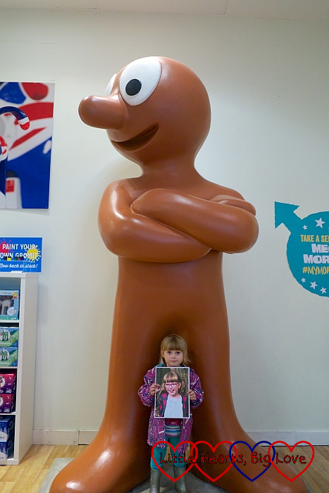 Sophie with a giant Morph in the Gromit Unleashed shop
