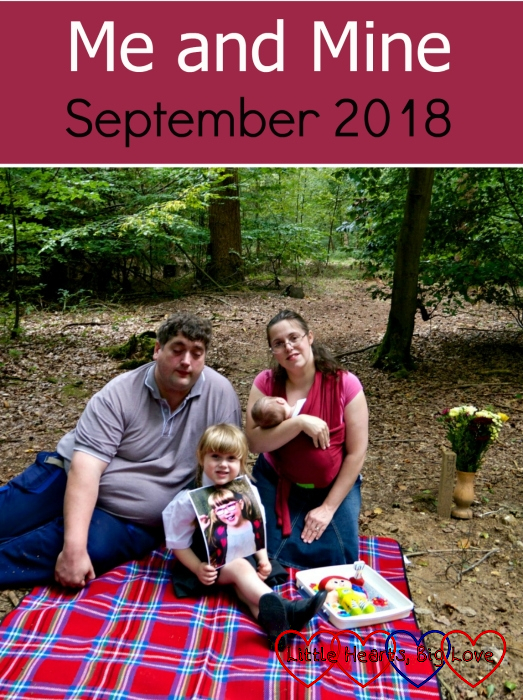 """Hubby, Sophie, me and Thomas sitting on a picnic blanket at Jessica's forever bed with a photo of Jessica and her """"Kerry"""" birthday cake - """"Me and Mine - September 2018"""""""