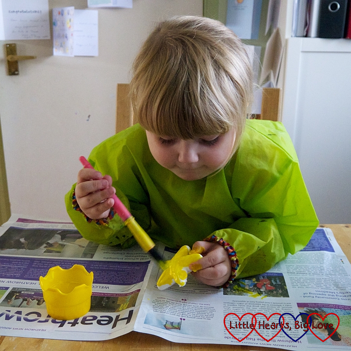 Sophie painting the polystyrene stars yellow