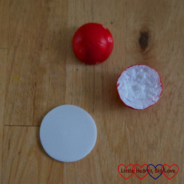 A polystyrene ball sliced in half with a craft foam circle