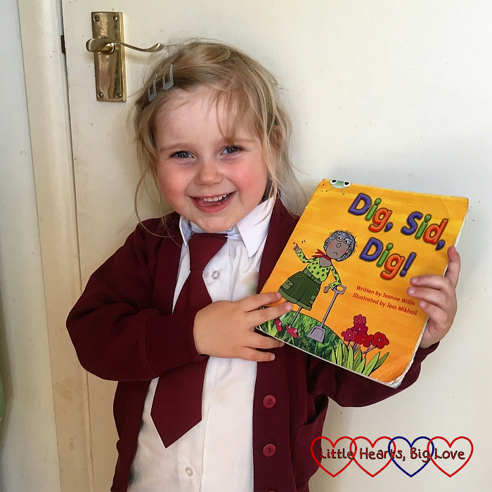 Sophie with her first reading book