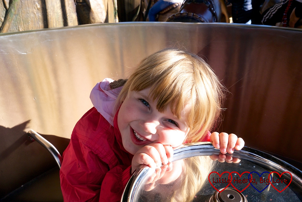 Sophie on the spinning cup on the Adventure Tree carousel at Chessington