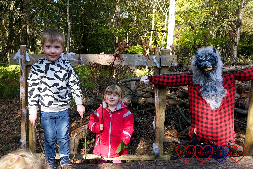 Sophie and her friend F standing next to a werewolf scarecrow at Black Park