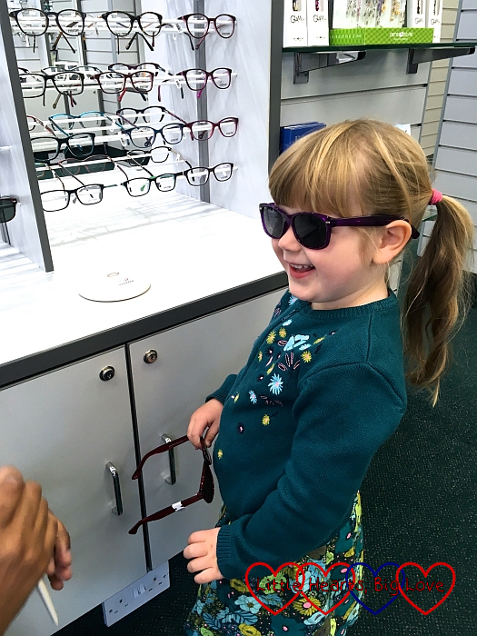 Sophie trying on her new sunglasses at the opticians