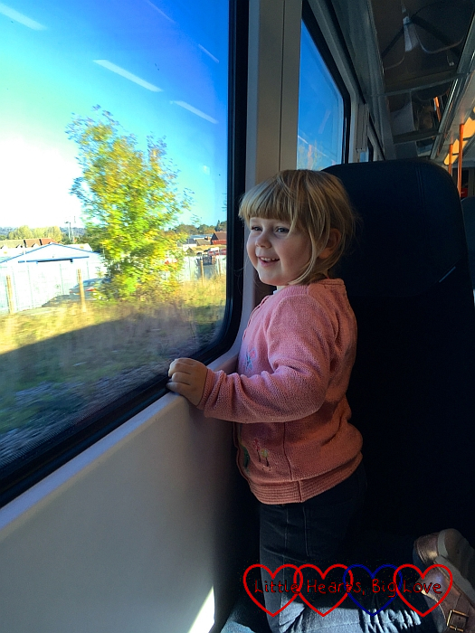 Sophie looking out of the window on the train