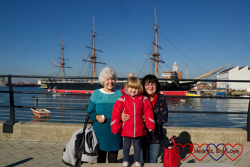My mum, Sophie and Auntie Maxine standing in front of HMS Warrior