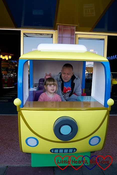 Sophie and Uncle Adrian in the Peppa Pig bus