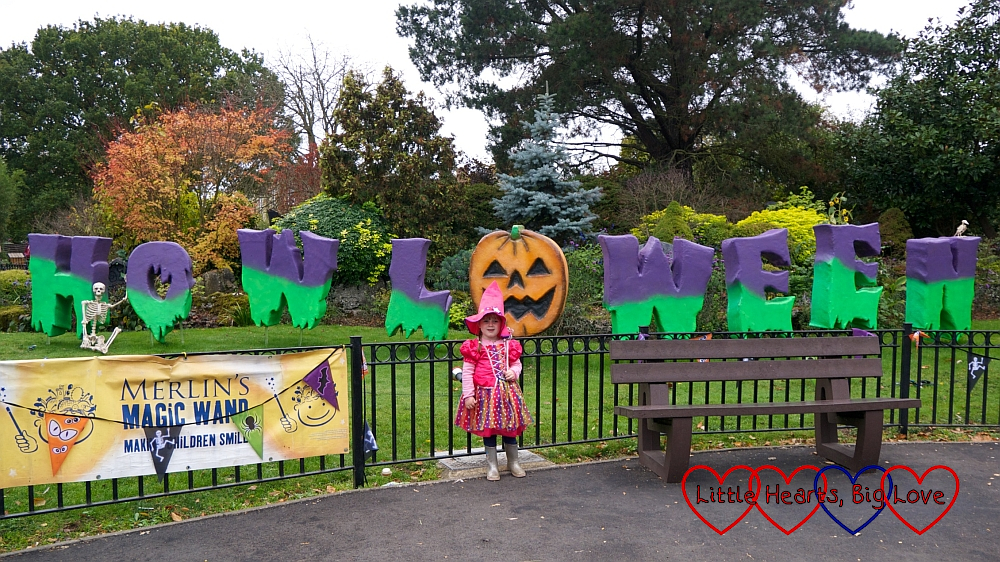 Sophie posing in front of the Howl'o'ween sign at Chessington
