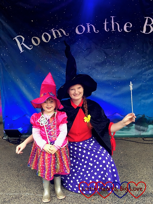 Sophie in her rainbow witch outfit with the Room on the Broom witch