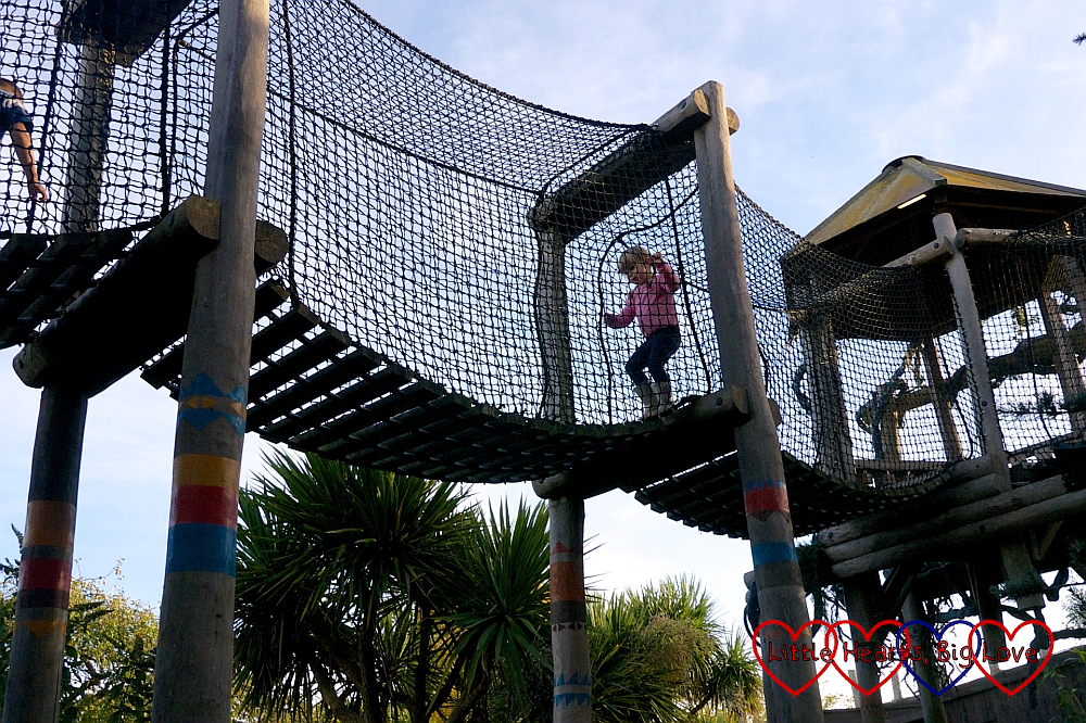 Sophie in the nets on the Amazu Treetop Adventure