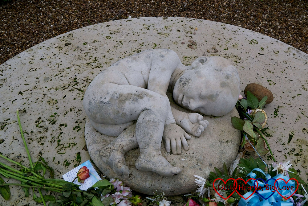 The sculpture of the baby in the centre of the SANDS garden
