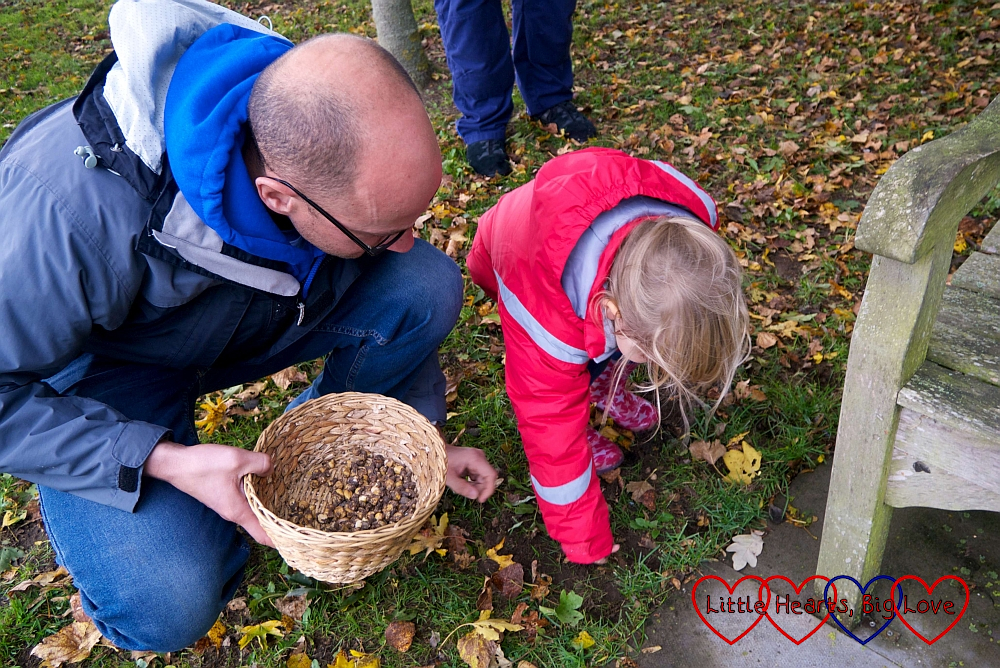 Sophie planting the bulbs with Ian's help