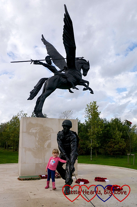 Sophie standing with the paratrooper on the Parachute Regiment and Airborne Forces National Memorial
